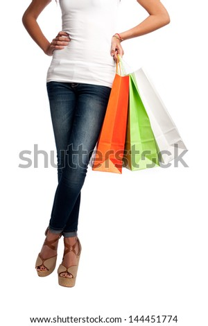 young woman holding shopping bags isolated on white background isolated on white background - stock photo