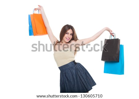 Young woman holding shopping bags isolated over white background - stock photo