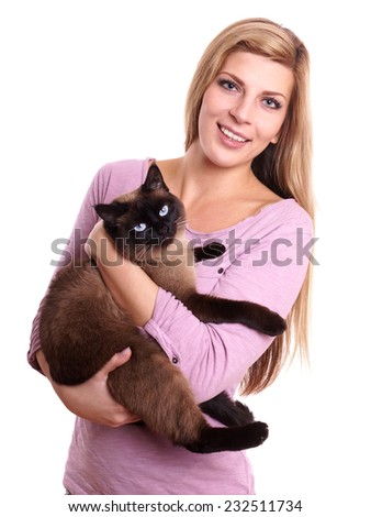 young woman holding siamese cat in her arms - stock photo