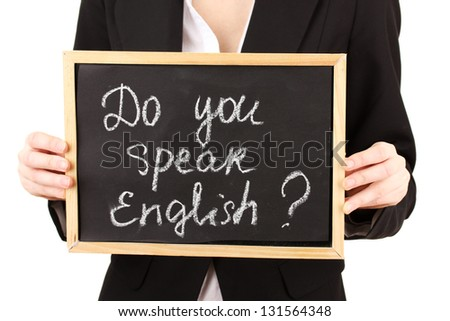 "Young woman holding sign ""Do you speak English?"""