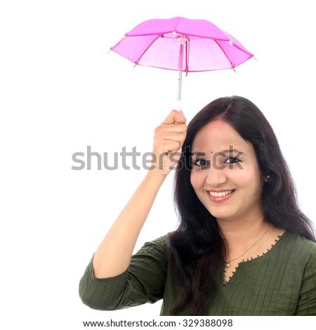 Young woman holding small umbrella - Money savings concept - stock photo