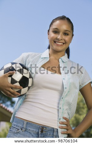 Young Woman Holding Soccer Ball - stock photo