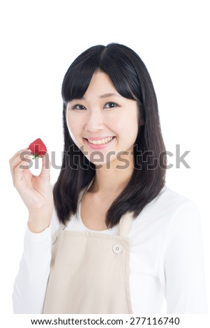 young woman holding strawberry isolated on white background