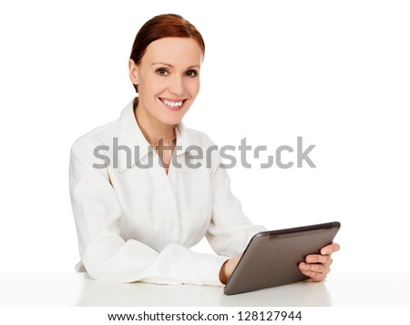 Young woman holding tablet computer, white background - stock photo