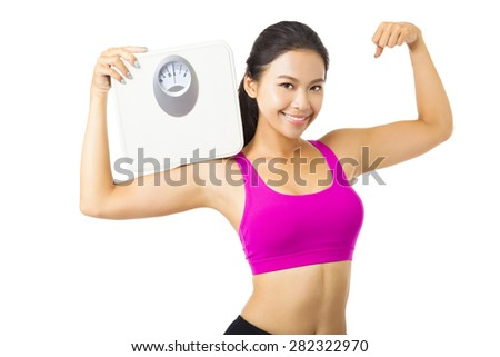 Young woman  holding the weight scale - stock photo