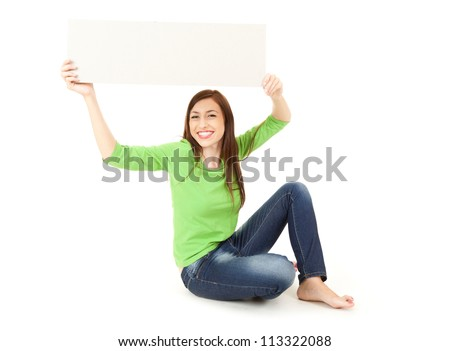 young woman holding up blank sign above his head, full length, white background - stock photo