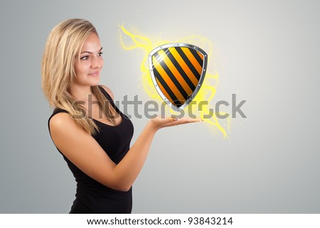 Young woman holding virtual shield sign - stock photo