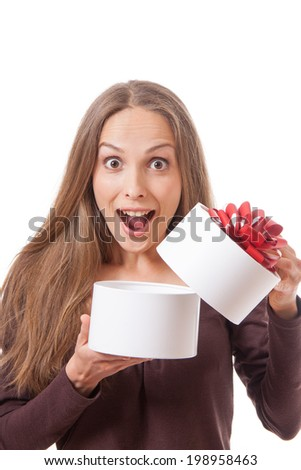 young woman holding white round gift box, isolated on white
