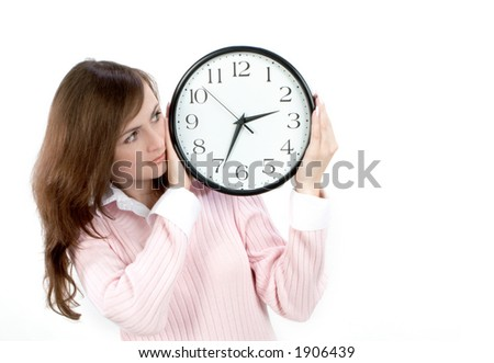 Young woman holding white whatch - stock photo
