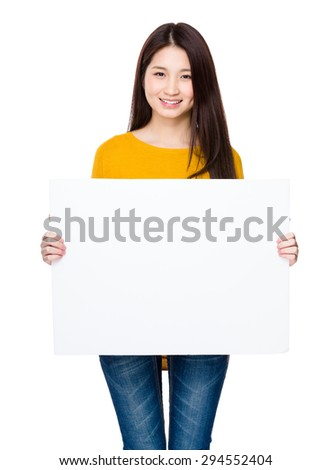 Young woman holding with placard