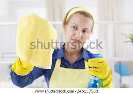 Young woman holding yellow mop and cleaning  - stock photo