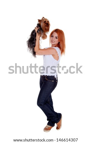 young woman holding yorkshire terrier