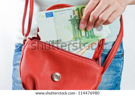 Young woman holds Euro banknotes - stock photo