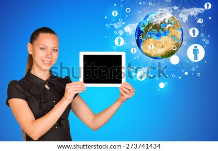 Young woman holging tablet looking at camera. Model of earth on blue background. Connection all over the world. Elements of this image furnished by NASA - stock photo