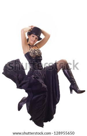 Young woman in a beautiful dress and a hat - stock photo