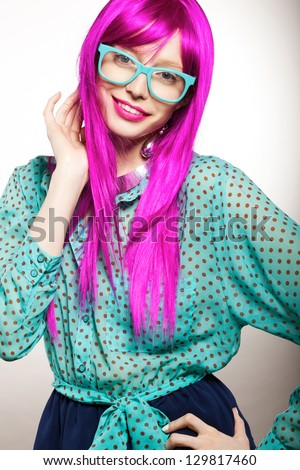 young woman in a bright purple wig, indoor - stock photo