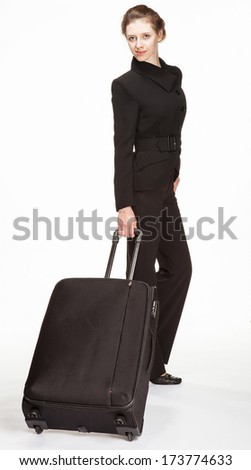 Young woman in a business suit with trunk, white background