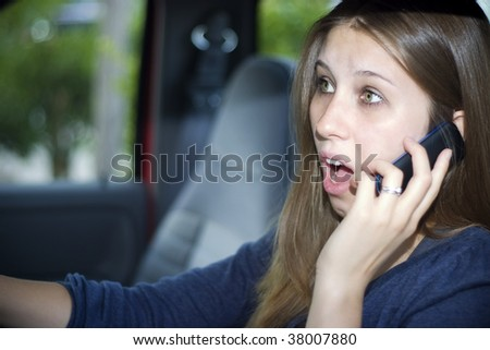 Young woman in a car looks very upset or scared.