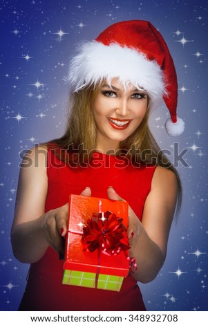 young woman in a Christmas costume on a black background - stock photo
