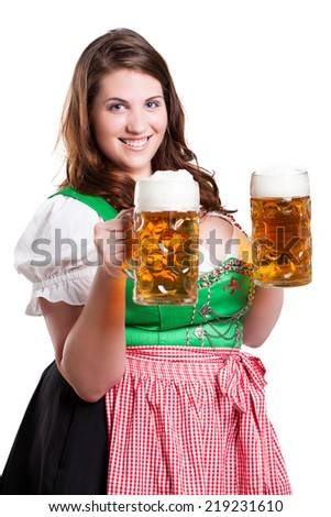 young woman in a dirndl with two beer  - stock photo