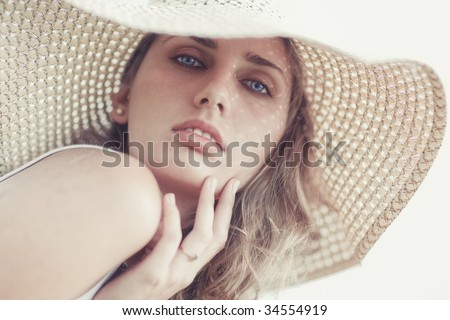 Young woman in a hat portrait. Bright soft colors.
