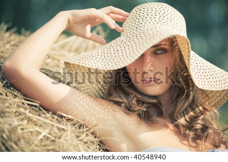 Young woman in a hat portrait. Soft colors.