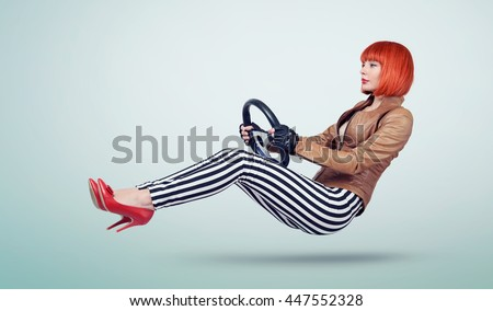 Young woman in a leather jacket and gloves driver car with a wheel, auto concept