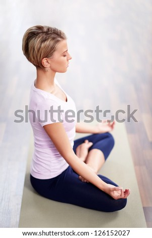 Young woman in a lotus position