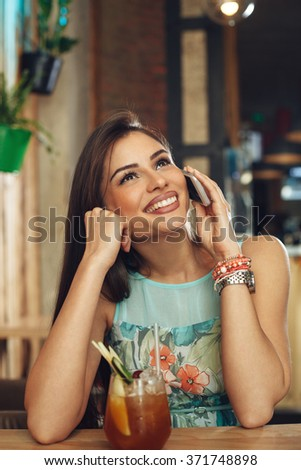 Young woman in a night out using mobile phone