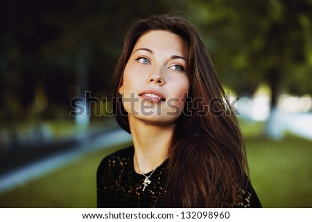 young woman in a park posing - stock photo
