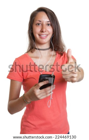 Young woman in a red shirt likes music - stock photo