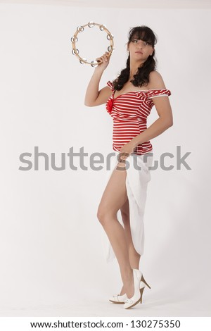 Young woman in a red skirt with white lace Shirt / Red + Stripes - stock photo