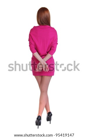 young woman in a skirt and blouse - back - stock photo