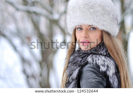 Young woman in a snowy furry hat