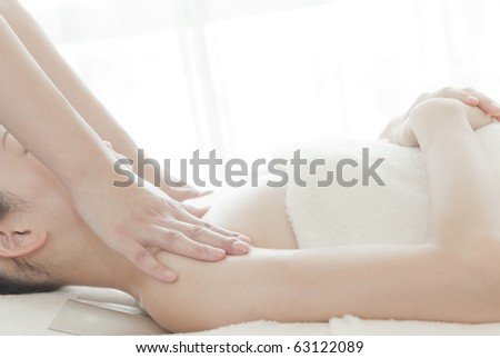 Young woman in a spa is getting a massage