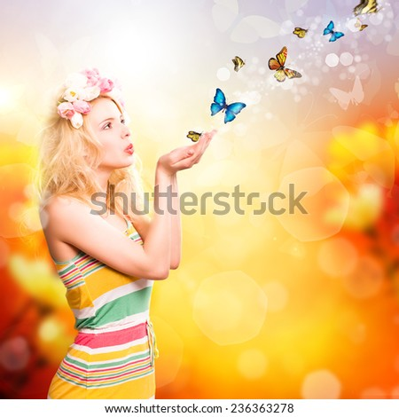 young woman in a spring environment and many butterflies - stock photo