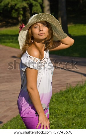 young woman in a straw hat  in park
