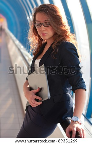 Young woman in a suit with a folder in his hands