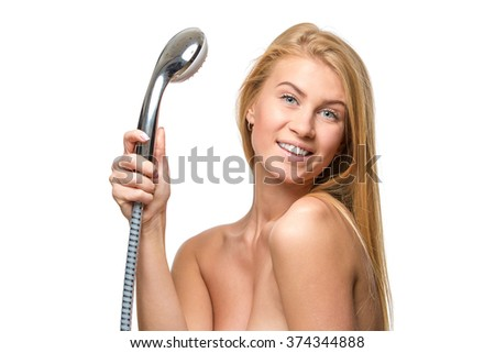 Young woman in a towel holding shower head  - stock photo