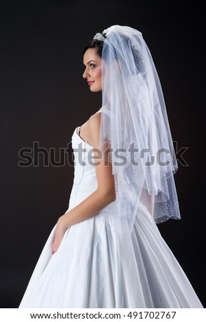 Young woman in a wedding dress