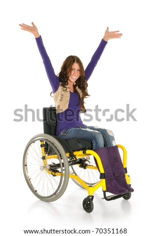 Young woman in a wheelchair smiling - stock photo