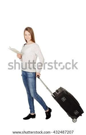 young woman in a white blouse standing with a suitcase holding a map. travel concept.