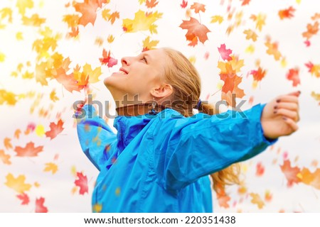 Young woman in autumn - stock photo