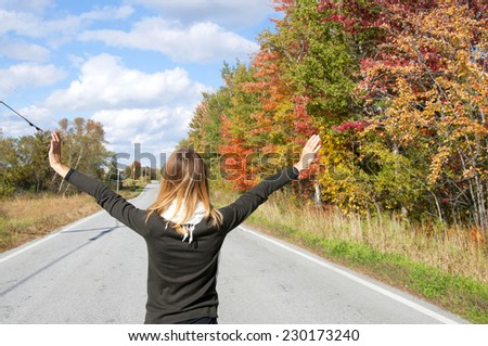 Young woman in autumn landscape, Vermont - stock photo