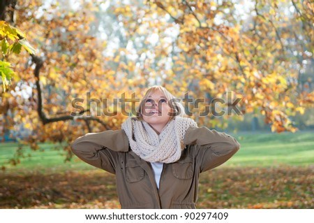 young woman in autumn park - stock photo