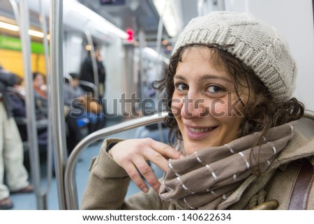 Young Woman in Barcelona Underground Train - stock photo