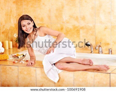 Young woman in  bathroom.