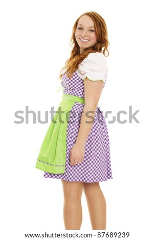 young woman in bavarian dress turning around on white background - stock photo