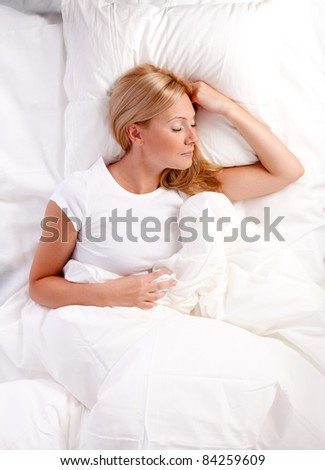 Young woman in bed.