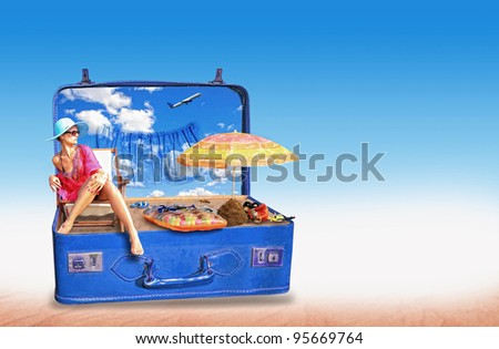 Young woman in bikini in a pink suitcase - Travel concept - stock photo